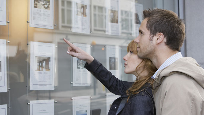 Young couple looking at properties